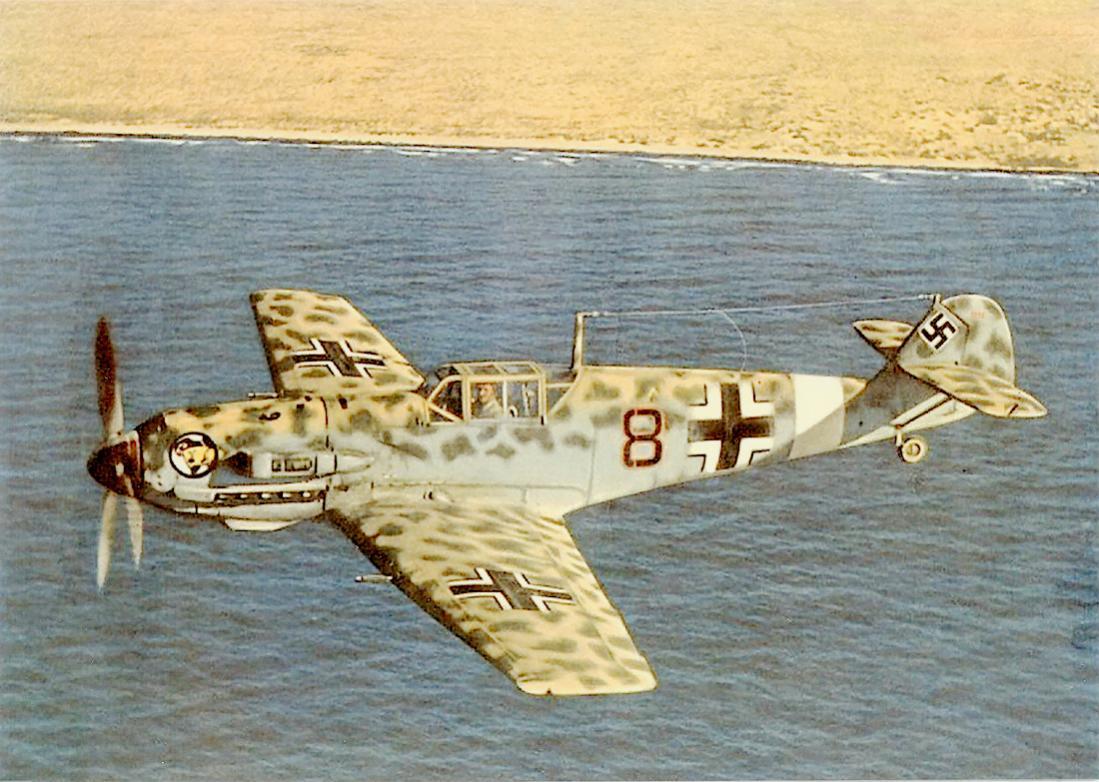 Naam: Foto 585. Bf 109 E-7:U2 (trop) van I.:JG 27 gevlogen door Oberleutnant Werner Schroer. 1100 bree.jpg Bekeken: 54 Grootte: 132,4 KB